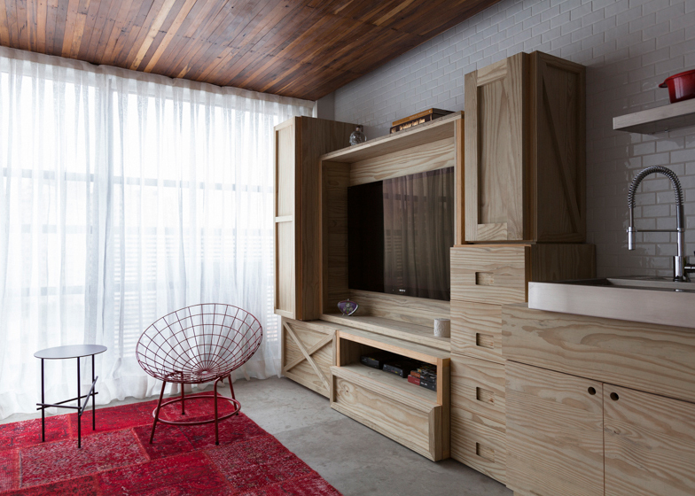 Compact-Apartment-With-Red-And-Wood